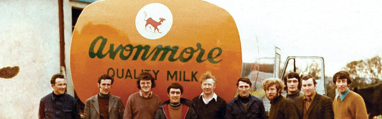 Old picture of glanbia ireland employees infront of avonmore milk truck